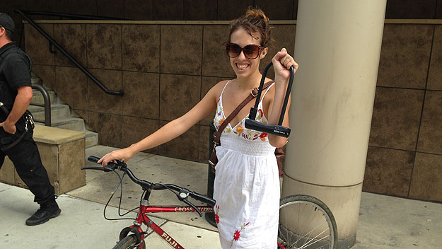 (Margarita Hoelper displays the bicycle lock that she got for registering her bike with campus security.  Photo by John McDevitt)