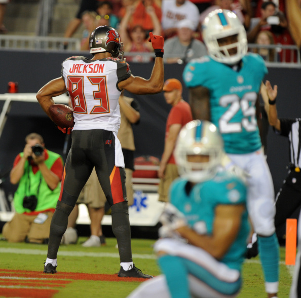 TAMPA, FL - AUGUST 16: Wide receiver Vincent Jackson #83 of the Tampa Bay Buccaneers celebrates his TD catch against the Miami Dolphins at Raymond James Stadium during a preseason game on August 16, 2014 in Tampa, Florida. (Photo by Cliff McBride/Getty Images)
