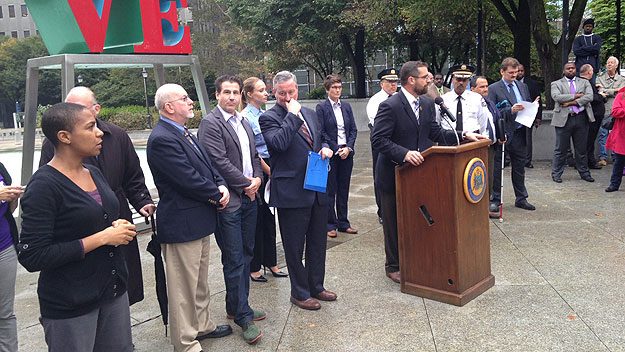 (Pa. state rep. Brian Sims addresses an anti-gay-bashing rally in Love Park.  Photo by Cherri Gregg)