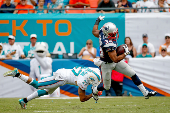 MIAMI GARDENS, FL - SEPTEMBER 07: Shane Vereen #34 of the New England Patriots avoids a tackle by Jimmy Wilson #27 of the Miami Dolphins of the game at Sun Life Stadium on September 7, 2014 in Miami Gardens, Florida.  (Photo by Rob Foldy/Getty Images)