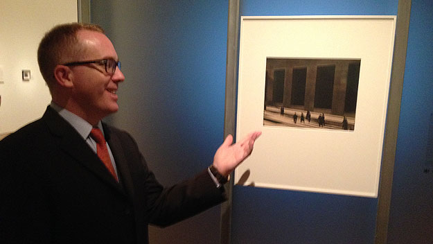 "(Peter Barberie with Paul Strand's ""Wall Street.""  Photo by Steve Tawa)"