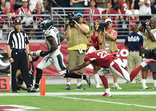 GLENDALE, AZ - OCTOBER 26:  Wide receiver Jeremy Maclin #18 of the Philadelphia Eagles runs in a 21 yard reception against free safety Rashad Johnson #26 of the Arizona Cardinals in the first quarter of the NFL game at University of Phoenix Stadium on October 26, 2014 in Glendale, Arizona.  (Photo by Norm Hall/Getty Images)