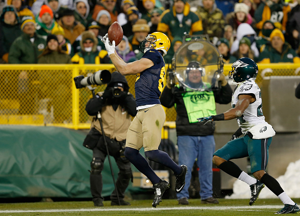 GREEN BAY, WI - NOVEMBER 16: Jordy Nelson #87 of the Green Bay Packers makes a touchdown pass reception against Bradley Fletcher #24 of the Philadelphia Eagles during the second quarter of the game at Lambeau Field on November 16, 2014 in Green Bay, Wisconsin. (Photo by Mike Zarrilli/Getty Images)