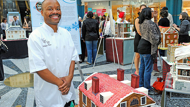 (Van Earl French Jr., at last year's event, with a gingerbread replica of an historic Philadelphia mansion.  Photo provided)