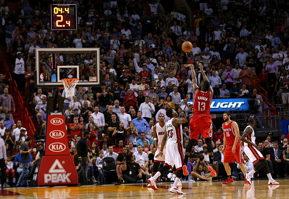 MIAMI, FL - NOVEMBER 04: James Harden #13 of the Houston Rockets shoots over Mario Chalmers #15 of the Miami Heat during a game  at American Airlines Arena on November 4, 2014 in Miami, Florida. (Photo by Mike Ehrmann/Getty Images)