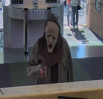(Surveillance video image from one of the robberies Clark Leary is accused of committing.)