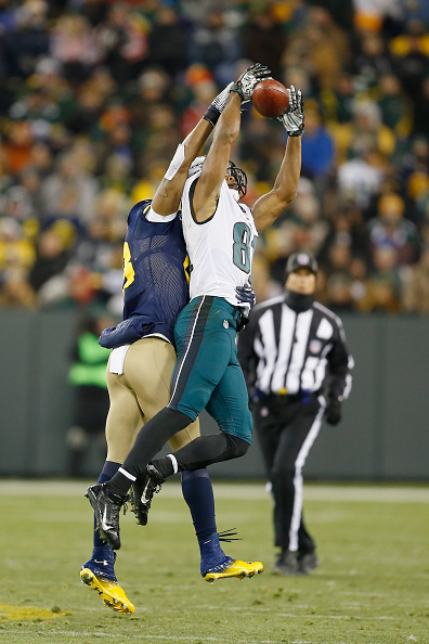 GREEN BAY, WI - NOVEMBER 16:   Jordan Matthews #81 of the Philadelphia Eagles makes a catch over Sean Richardson #28 of the Green Bay Packers during the fourth quarter of the game at Lambeau Field on November 16, 2014 in Green Bay, Wisconsin.  (Photo by Mike Zarrilli/Getty Images)