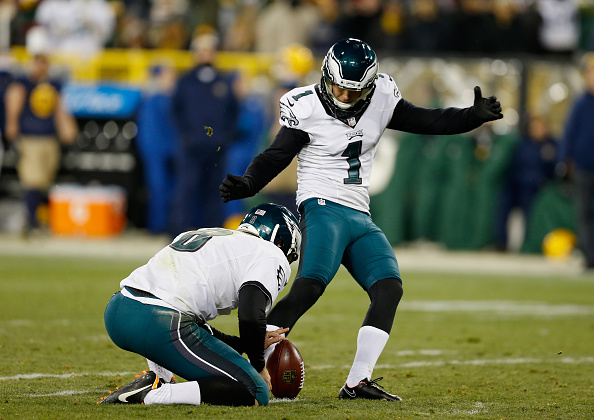 GREEN BAY, WI - NOVEMBER 16:  Kicker  Cody Parkey #1 of the Philadelphia Eagles kicks a field goal held by punter  Donnie Jones #8 of the Philadelphia Eagles during the second quarter of the game at Lambeau Field on November 16, 2014 in Green Bay, Wisconsin.  (Photo by Mike Zarrilli/Getty Images)