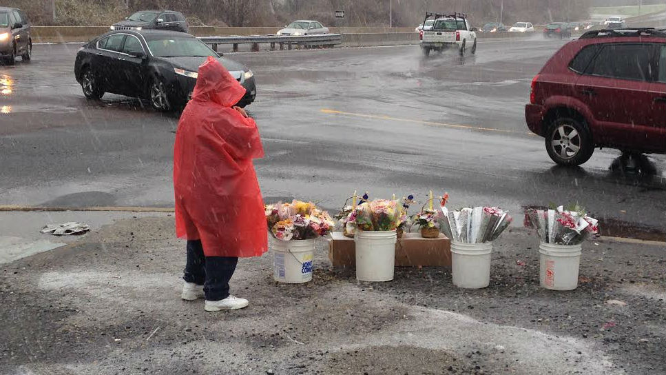 Renee is selling flowers to people making their way through northeast Philadelphia on the day before Thanksgiving. (Credit: Tony Hanson)