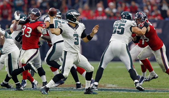 HOUSTON, TX - NOVEMBER 02:  Mark Sanchez #3 of the Philadelphia Eagles looks for a receiver against the Houston Texans at Reliant Stadium on November 2, 2014 in Houston, Texas.  (Photo by Bob Levey/Getty Images)