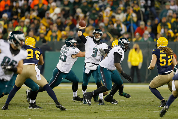 GREEN BAY, WI - NOVEMBER 16:  Quarterback  Mark Sanchez #3 of the Philadelphia Eagles passes against the Green Bay Packers during the third quarter of the game at Lambeau Field on November 16, 2014 in Green Bay, Wisconsin.  (Photo by Mike Zarrilli/Getty Images)