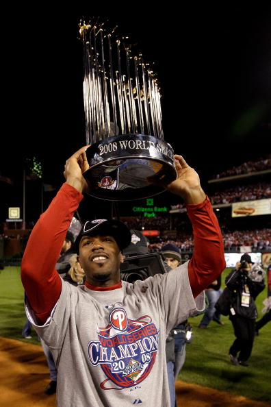 PHILADELPHIA - OCTOBER 29:  Jimmy Rollins #11 of the Philadelphia Phillies celebrates with the World Series Championship trophy after their 4-3 win against the Tampa Bay Rays during the continuation of game five of the 2008 MLB World Series on October 29, 2008 at Citizens Bank Park in Philadelphia, Pennsylvania.  (Photo by Pool/Getty Images)