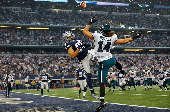 ARLINGTON, TX - NOVEMBER 27:  Defensive back Sterling Moore #26 of the Dallas Cowboys breaks up a pass intended for wide receiver Riley Cooper #14 of the Philadelphia Eagles at AT&T Stadium on November 27, 2014 in Arlington, Texas.  (Photo by Tom Pennington/Getty Images)
