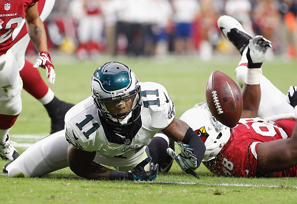 GLENDALE, AZ - OCTOBER 26: Wide receiver Josh Huff #11 of the Philadelphia Eagles fumbles the football forced by defensive end Frostee Rucker #98 of the Arizona Cardinals in the second quarter during the NFL game at the University of Phoenix Stadium on October 26, 2014 in Glendale, Arizona. (Photo by Christian Petersen/Getty Images)