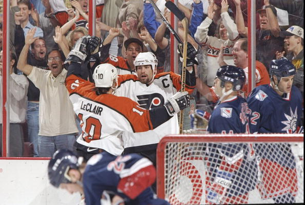 25 May 1997: Eric Lindros of the Philadelphia Flyers celebrates with teammate John LeClair after they defeated the New York Rangers 4-2 during the Eastern Conference Playoffs at Corestate Center in Philadelphia, Pennsylvania. Mandatory Credit: Robert Lab