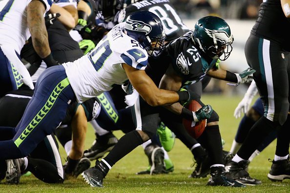 PHILADELPHIA, PA - DECEMBER 07:  LeSean McCoy #25 of the Philadelphia Eagles fumbles the ball and it is recovered by K.J. Wright #50 of the Seattle Seahawks during the third quarter of the game at Lincoln Financial Field on December 7, 2014 in Philadelphia, Pennsylvania.  (Photo by Al Bello/Getty Images)