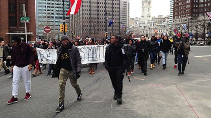 (A protest group marches along the Benjamin Franklin Parkway enroute to the Philadelpha Museum of Art.  Photo by KYW's Pat Loeb)