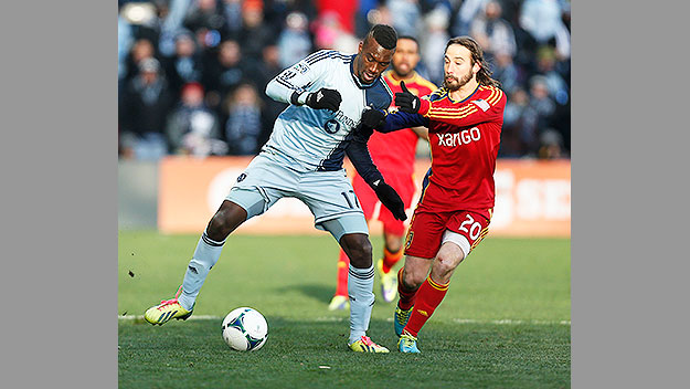 (CJ Sapong, in white, playing for Sporting Kansas City in the MLS Cup Final, December 2013.  Photo by Ed Zurga/ Getty Images)