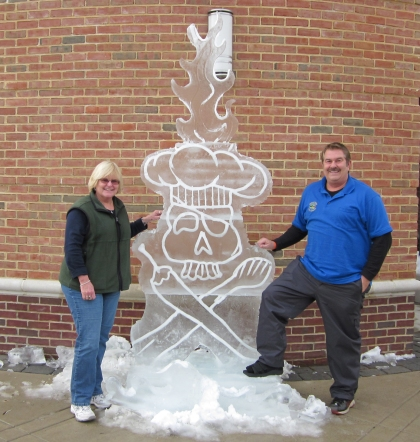 Dudley Rice and wife, Gretchen, with one of the Winter Festival live ice sculptures. (Credit: Lambertville New Hope Winter Festival)