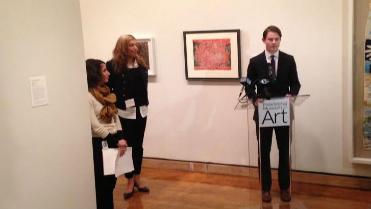 John Vick discussing the exhibit. Dr. Shaw is on his immediate left. (Credit: Cherri Gregg/KYW)