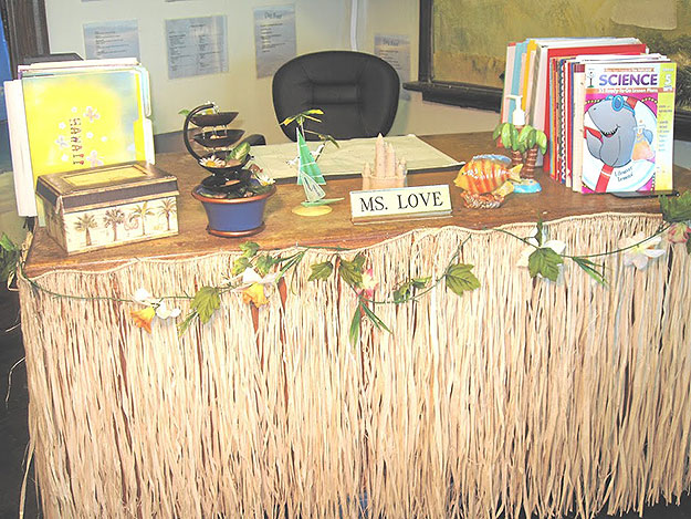 "(Love's classroom desk sports a grass ""skirt.""   Photo provided by Susan Love)"