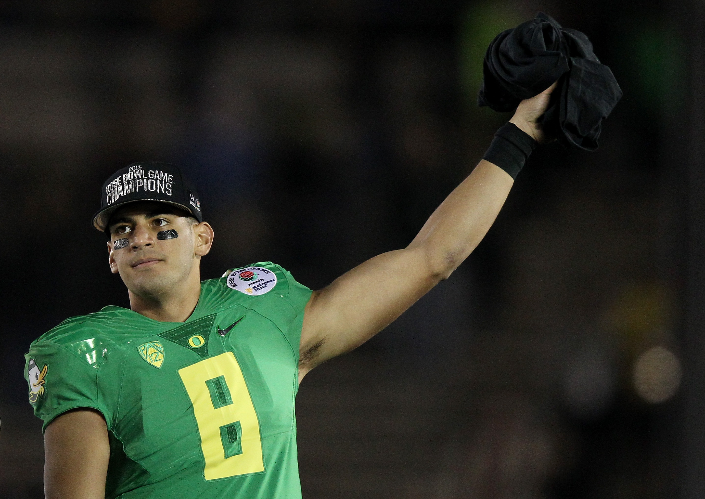 PASADENA, CA - JANUARY 01: Quarterback Marcus Mariota #8 of the Oregon Ducks reacts after defeating the Florida State Seminoles 59-20 in the College Football Playoff Semifinal at the Rose Bowl Game presented by Northwestern Mutual at the Rose Bowl on January 1, 2015 in Pasadena, California. (Photo by Ezra Shaw/Getty Images)
