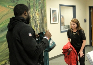 Hannah Delmonte reacts to the surprise of Emmanuel Acho presenting her with a special Eagles jersey. (credit: Chris Barletto/PhiladelphiaEagles)