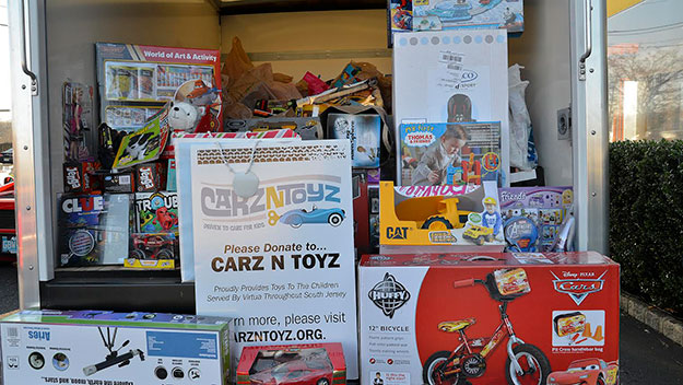 (A truck is loaded with donated toys for Carz N' Toyz.  Photo provided)