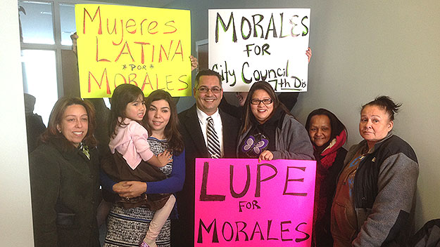 (Manny Morales is surrounded by family members and supporters at Democratic Party headquarters.  Photo by Steve Tawa)