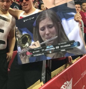 Villanova's crying piccolo girl was among the cutouts in the crowd at Temple's game on Wednesday night. (credit: