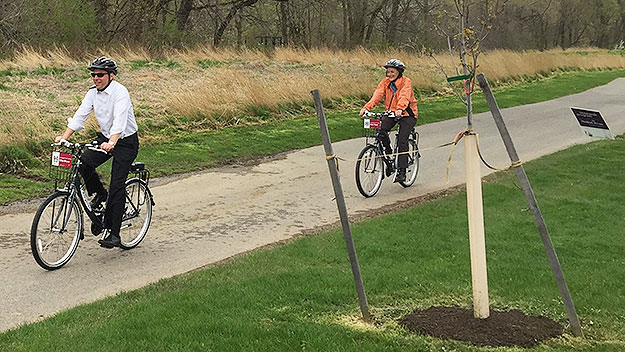 (County commissioners Josh Shapiro, left, and Val Arkoosh take their newly rented bicycles for a spin.  Photo by Jim Melwert)