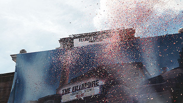 (Smoke, confetti cannons, and a huge painted drape over the façade accompanied today's announcement.  Photo by Pat Loeb)