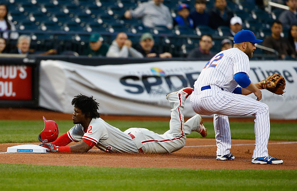 NEW YORK, NY - APRIL 15:  Odubel Herrera #37 of the Philadelphia Phillies slides safely into third base with a triple avoiding the tag of Eric Cambell #29 of the New York Mets during their game at Citi Field on April 15, 2015 in New York City.  (Photo by Al Bello/Getty Images)