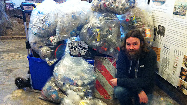 (Bradley Maule, with some of the items he collected over a year in Fairmount Park.  Photo by Lauren Lipton)