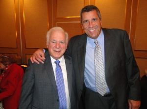 Stan Hochman poses for a picture alongside 94 WIP's Angelo Cataldi at the Broadcast Pioneers dinner in 2012. (credit: Cindy Webster)