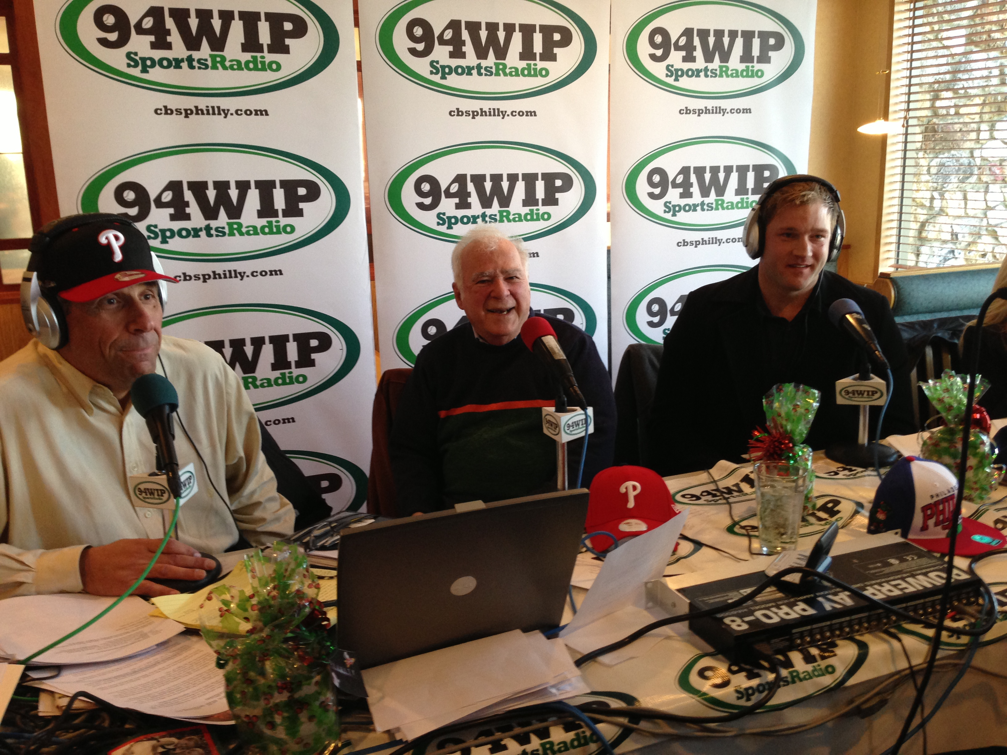 Stan Hochman (center) with Angelo Cataldi (left) and Todd Fedoruk (right)  at the WIP Morning Show Christmas Party in 2013.