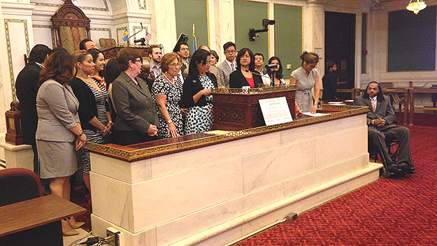 (A large number of city officials were on hand in City Council chambers to urge passage of ballot question #3.  Photo by Cherri Gregg)