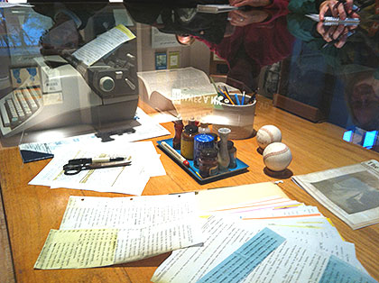 (James Michener's desk, in his former home, is protected in a glass case along with tools and mementos of the late author.  Photo by Lauren Lipton)