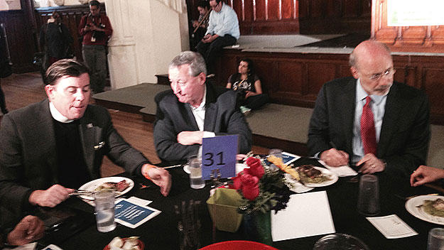 (Jim Kenney, center, shares a luncheon table with Broad Street Ministry pastor Bill Golderer, left, and Gov. Tom Wolf, right.  Photo by Pat Loeb)