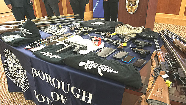(Some of the items seized in the probe of drug gang violence in the Pottstown area.  Photo by Jim Melwert)