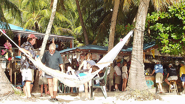 (This beach bar in the Caribbean provides a hammock for its customers to relax in.  Photo by Richard Maloney)