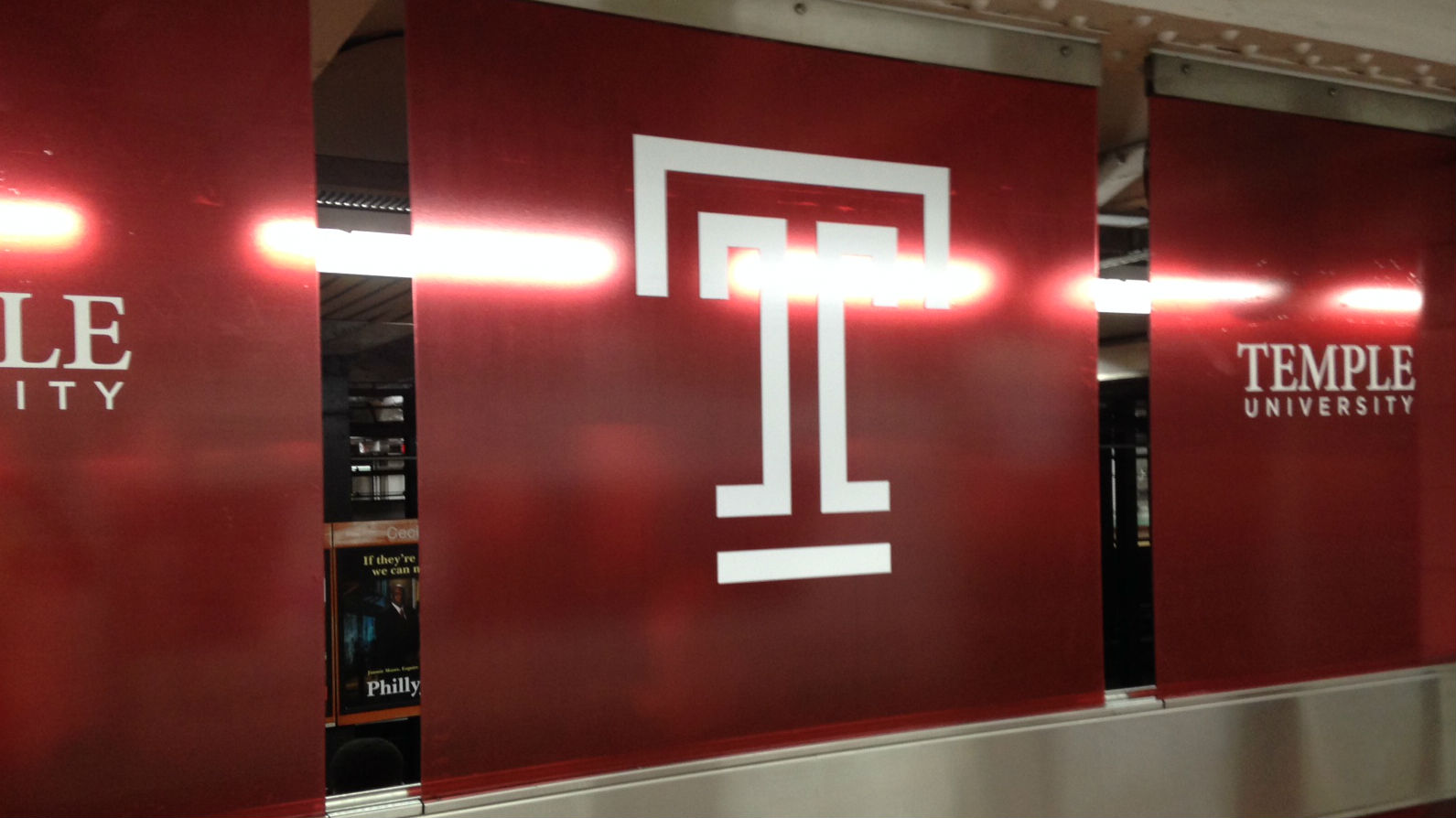 New Temple University signage on the southbound side of Cecil B. Moore station. (Credit: Cherri Gregg)
