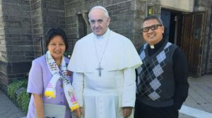 "Sister Gertrude Borres and Father Efren Esmilla with ""Pop Up"" Pope Francis. (credit: Tim Jimenez)"