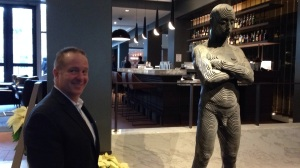 "Santore with the lobby's ""Iron Man"" sculpture (credit: Mike DeNardo)"