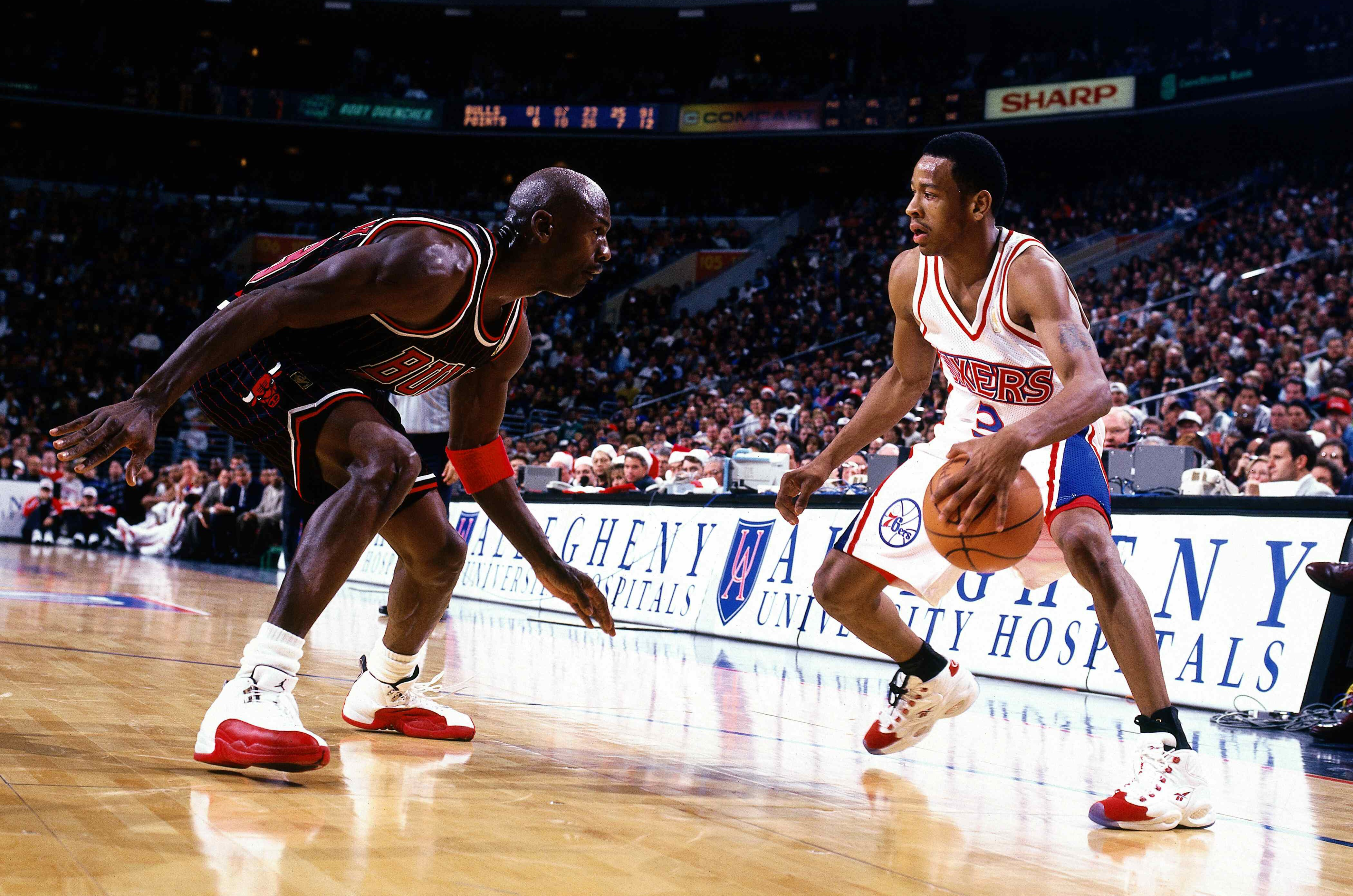 PHILADELPHIA - 1997: Allen Iverson #3 of the Philadelphia 76ers faces off at the perimeter against Michael Jordan #23 of the Chicago Bulls at the First Union Center during the 1997 NBA season in Philadelphia, Pennsylvania. Copyright 1997 NBAE (Photo by Lou Capozzola/NBAE/Getty Images)