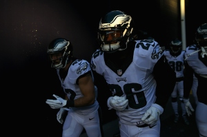 FOXBORO, MA - DECEMBER 06:  Chris Maragos #42 and Walter Thurmond #26 of the Philadelphia Eagles run onto the field prior to the game against the New England Patriots at Gillette Stadium on December 6, 2015 in Foxboro, Massachusetts.  (Photo by Maddie Meyer/Getty Images)