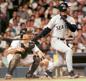 NEW YORK, UNITED STATES: Seattle Mariners' Ken Griffey Jr. (R) watches his opposite field three-run home run off the New York Yankees David Wells sail over the left field wall in the fourth inning in New York 25 July. The home run, Griffey's 31st of the year, put the Mariners up 8-1 and knocked Wells out of the game. AFP PHOTO Henny Ray ABRAMS (Photo credit should read HENNY RAY ABRAMS/AFP/Getty Images)