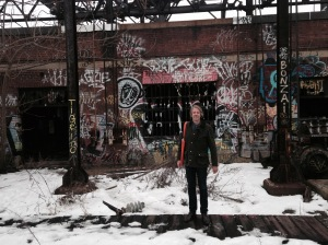 Michael Garden stands by a building Friends of the Rail Park hopes some day to restore (photo credit Pat Loeb)