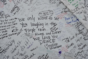 Messages left by Prince fans as they pay their respects outside the Paisley Park residential compound in Minneapolis, Minnesota, on April 22, 2016. Prince died April 21, 2016. / AFP / Mark Ralston (Photo credit should read MARK RALSTON/AFP/Getty Images)