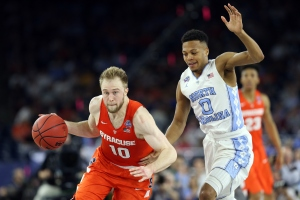 HOUSTON, TEXAS - APRIL 02:  Trevor Cooney #10 of the Syracuse Orange dribbles the ball against Nate Britt #0 of the North Carolina Tar Heels in the second half during the NCAA Men's Final Four Semifinal at NRG Stadium on April 2, 2016 in Houston, Texas.  (Photo by Streeter Lecka/Getty Images)